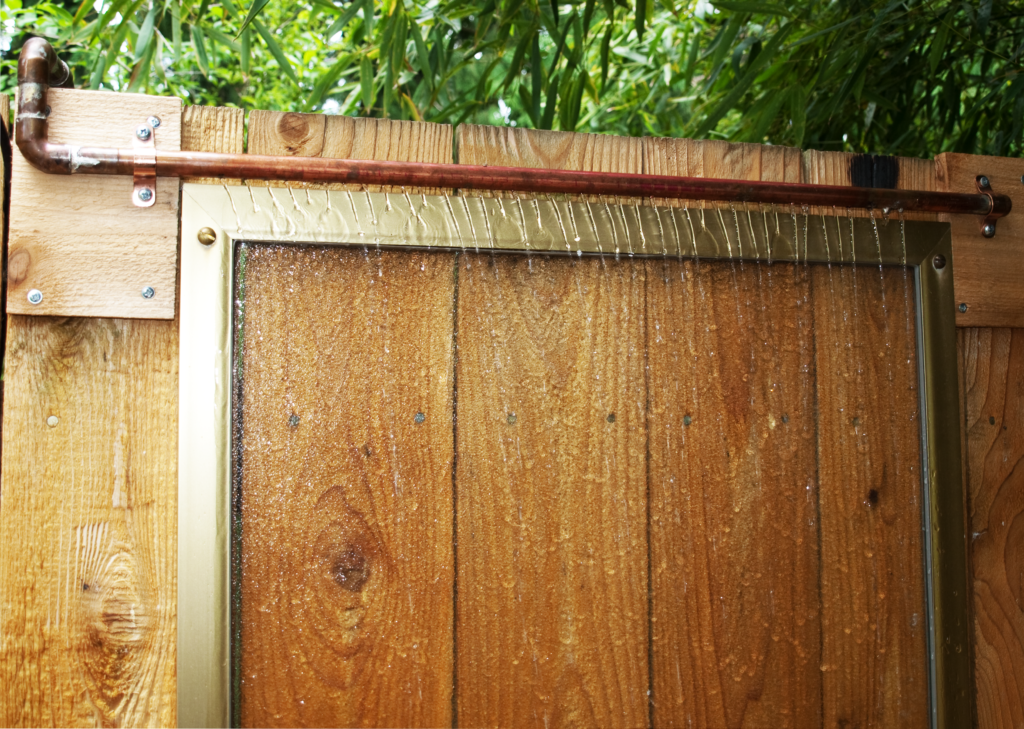 DIY Waterfall Feature For Backyard Fence