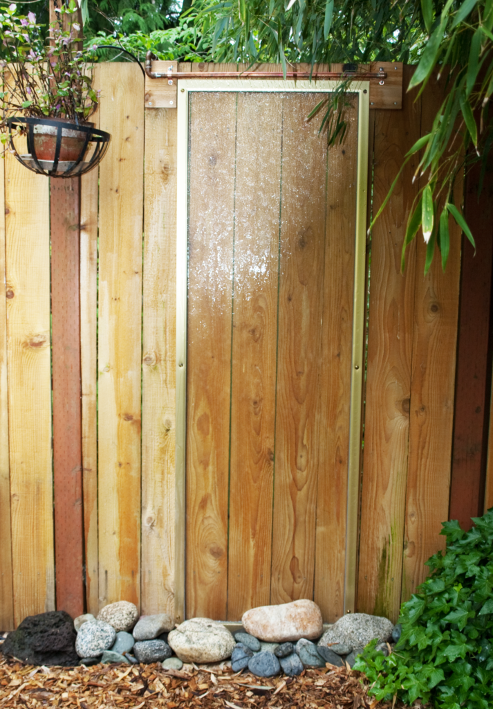 Photo of DIY Waterfall Feature For Backyard Fence